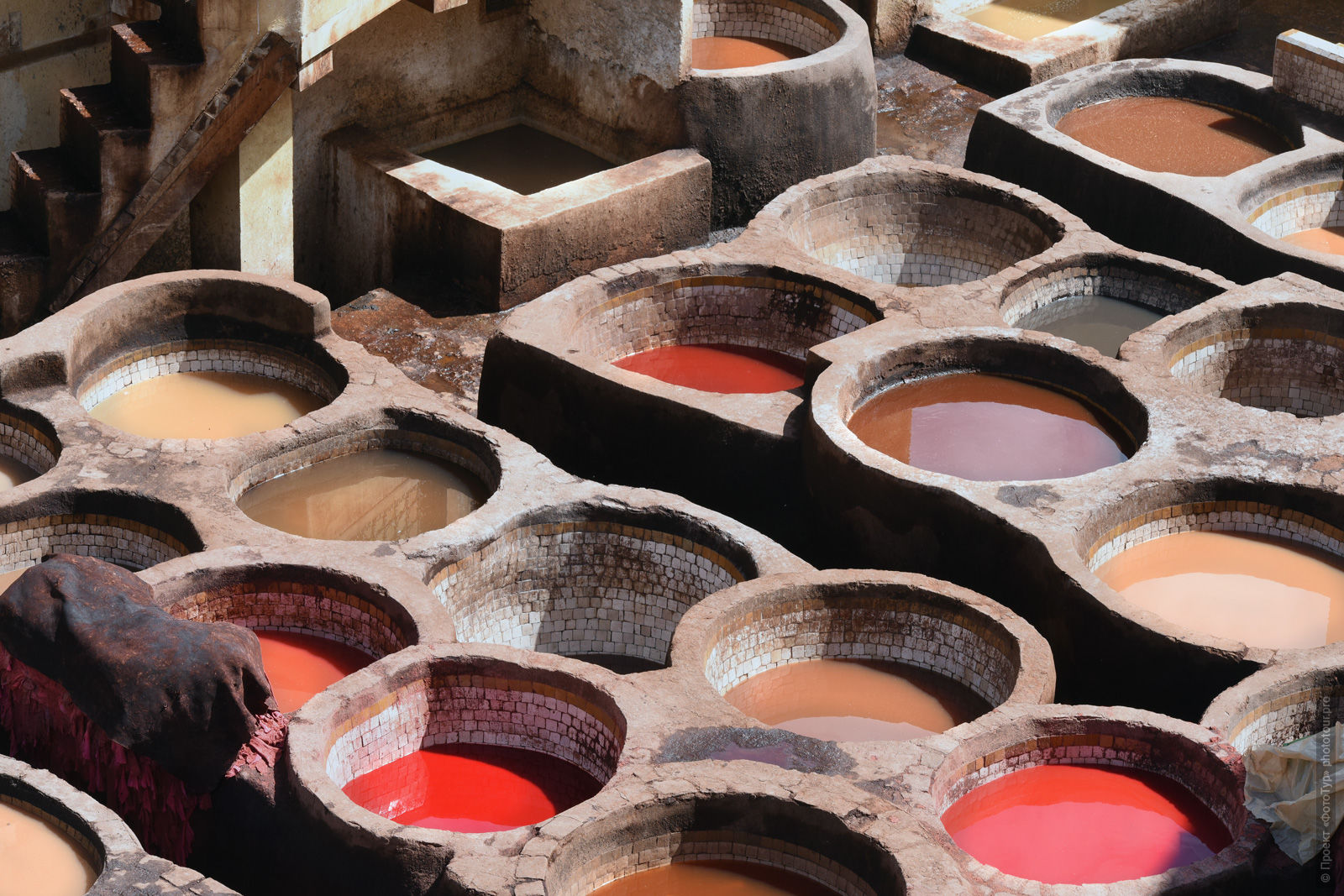 Baths with paint in the dyeing room of Shuar. Morocco, photo tour of Morocco, October 2018.