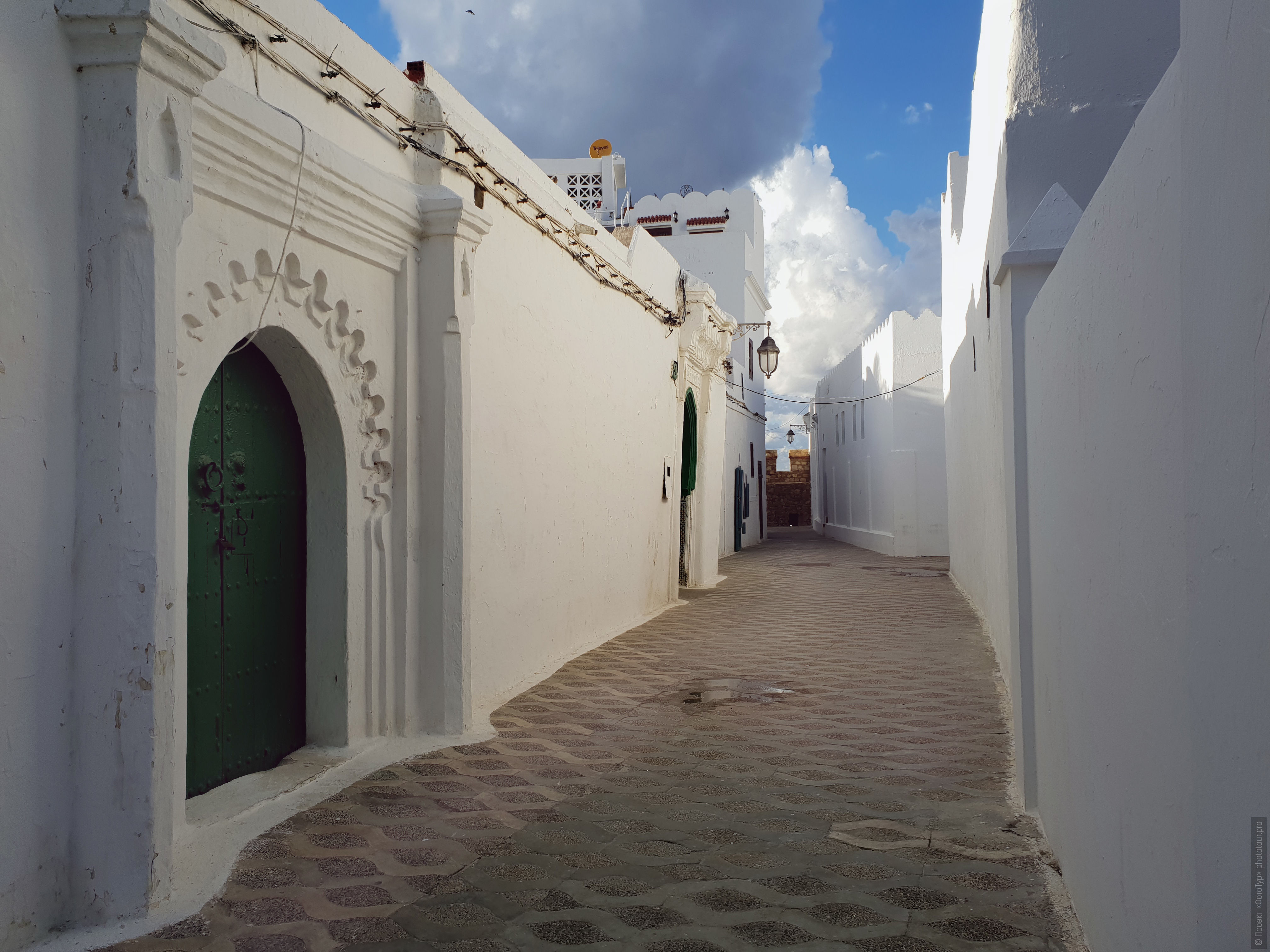 The narrow streets of Asila. Adventure photo tour: medina, cascades, sands and ports of Morocco, April 4 - 17, 2020.