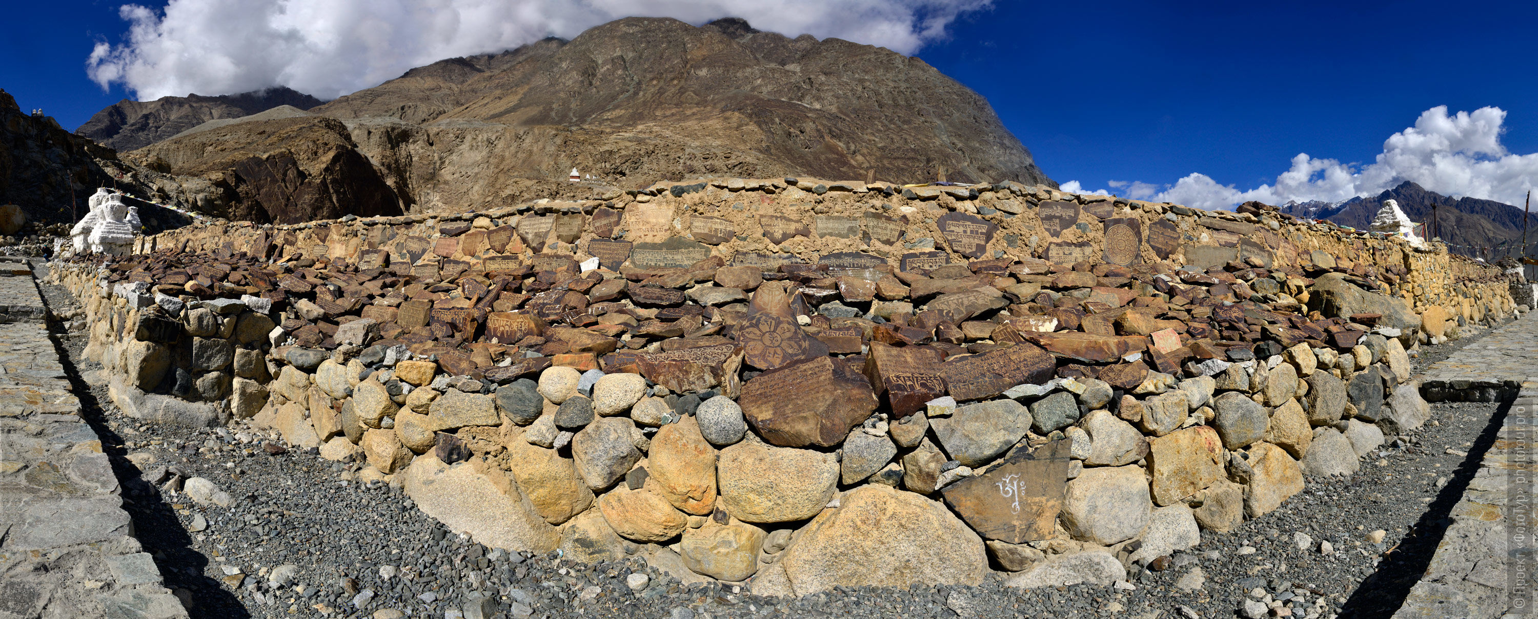 The biggest in Nybro wall with prayer stones. The settlement of the disc. Tour in Nubra valley, Ladakh, in October 2017.